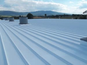 coated metal roof on large building