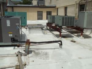 spray foam around equipment on a roof